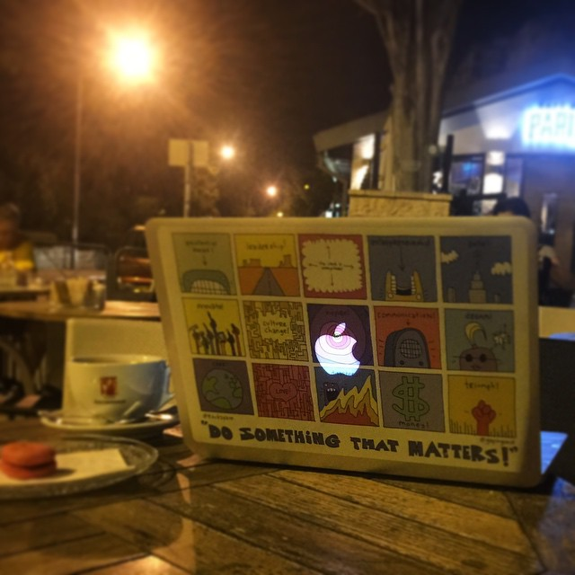 Alan's Facebook Cover Photo - His laptop at a sidewalk cafe